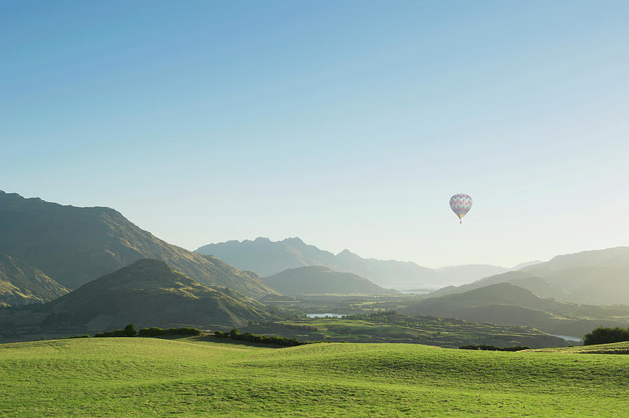 Hot Air Balloon Flying Above Rolling Photograph by Jacobs Stock Photography Ltd