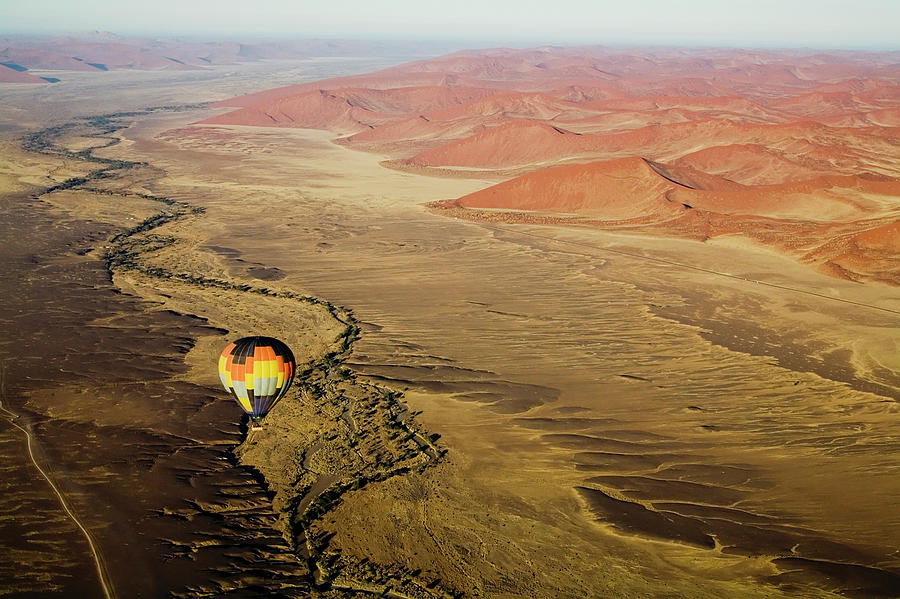 Hot Air Balloon Over Desert Landscape Photograph by Cultura Exclusive/led