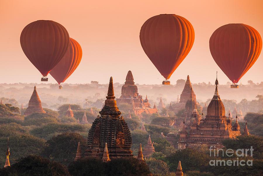 Dusk Photograph - Hot Air Balloon Over Plain Of Bagan In by Lkunl