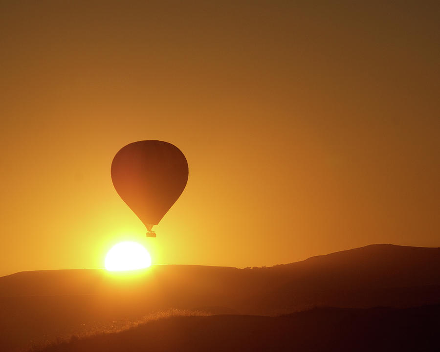 Hot-air Balloon Over Rising Sun Photograph by Wu Swee Ong