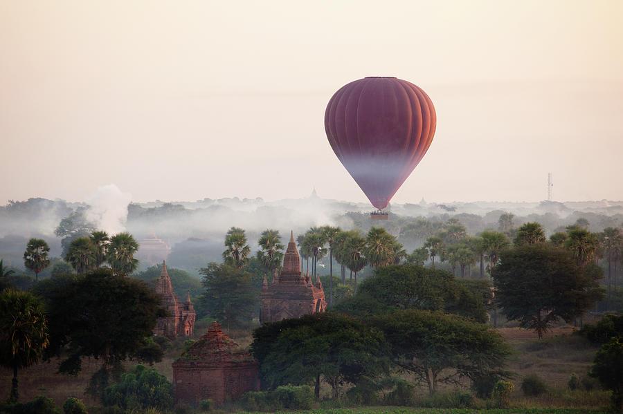 Hot-air Balloon Rising In Bagan Photograph by Wu Swee Ong