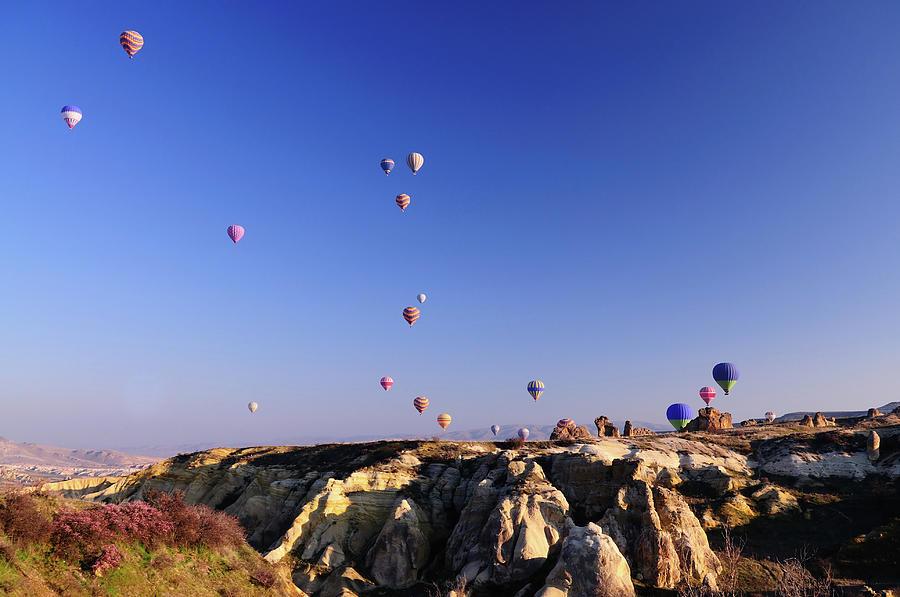 Hot Air Balloons At The Capadoccia Sky Photograph by Deliormanli