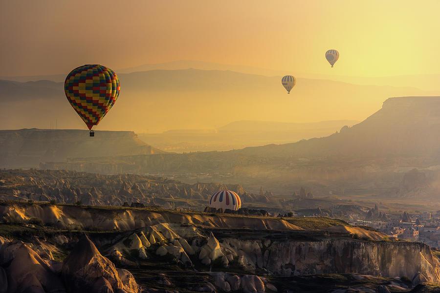 Hot Air Balloons Over Cappadocia Photograph by Coolbiere Photograph