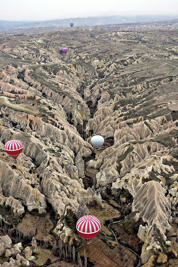 Hot Air Balloons Over Fairy Chimneys In Photograph by Gregory T. Smith