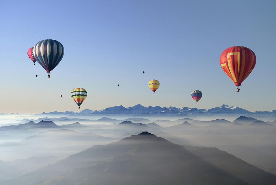 Hot Air Balloons Over Mountain Skyline Photograph by © Axel Lauerer