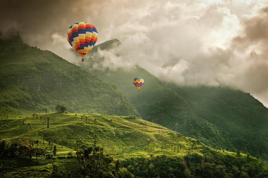 Hot Air Balloons Over Tea Plantations Photograph by Nicolo Sertorio