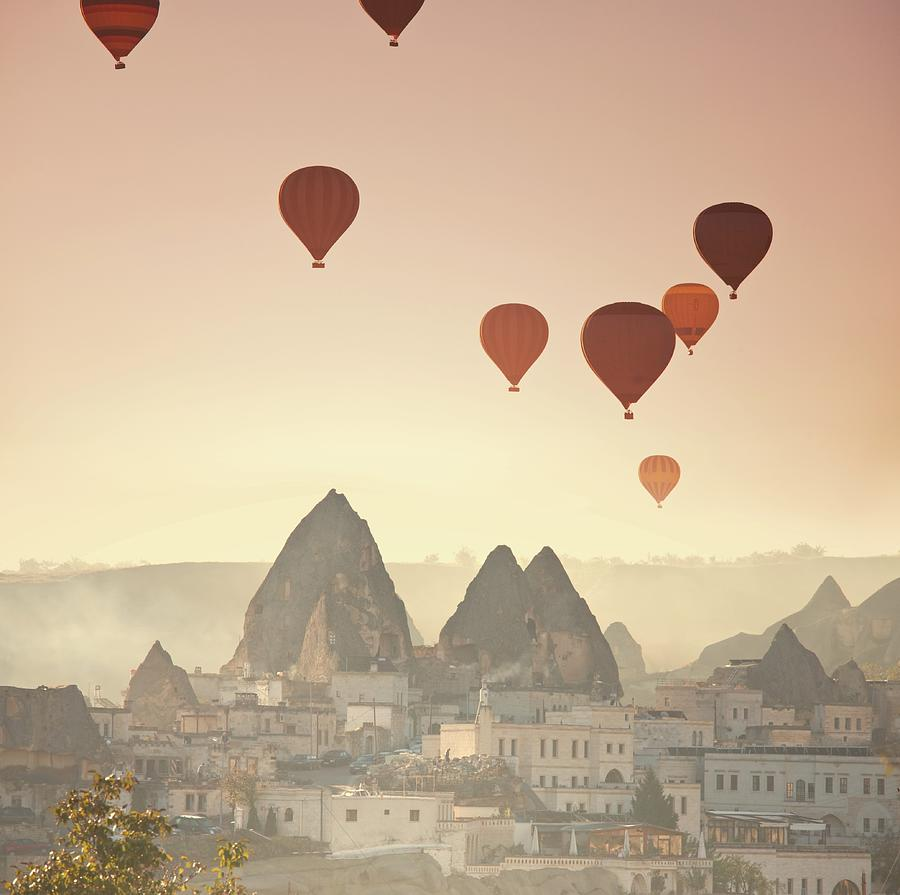 Hot Air Balloons Over Town Photograph by Ingram Publishing
