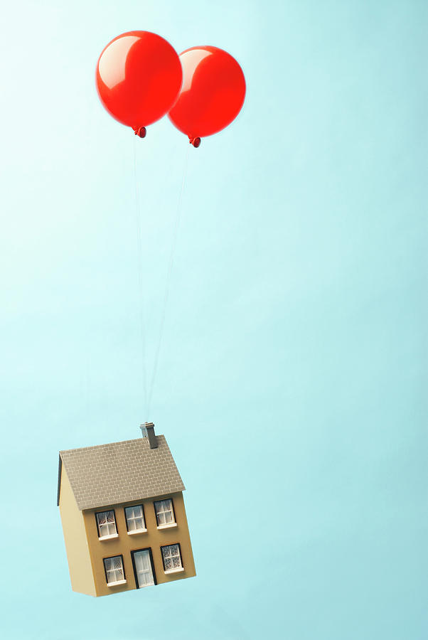 House Floating Away With Two Balloons Photograph by Peter Muller