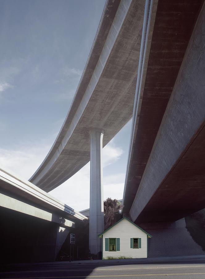 House Under Freeways Photograph by Ed Freeman