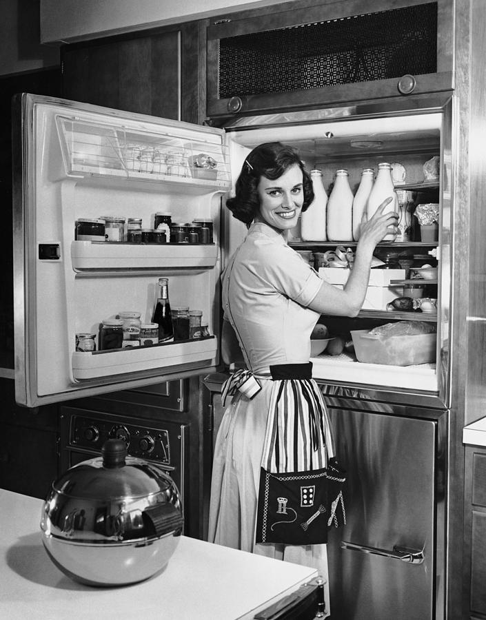 House Wife Removing Milk From Photograph by George Marks