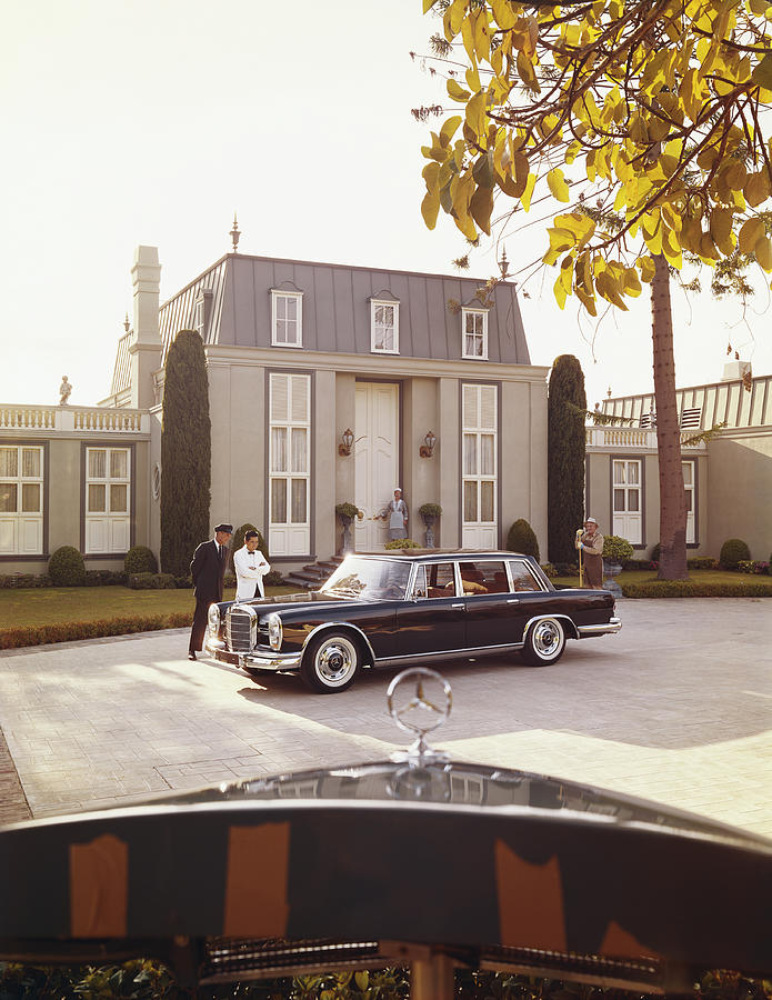 People Photograph - House Workers And Staff Looking At Car by Tom Kelley Archive