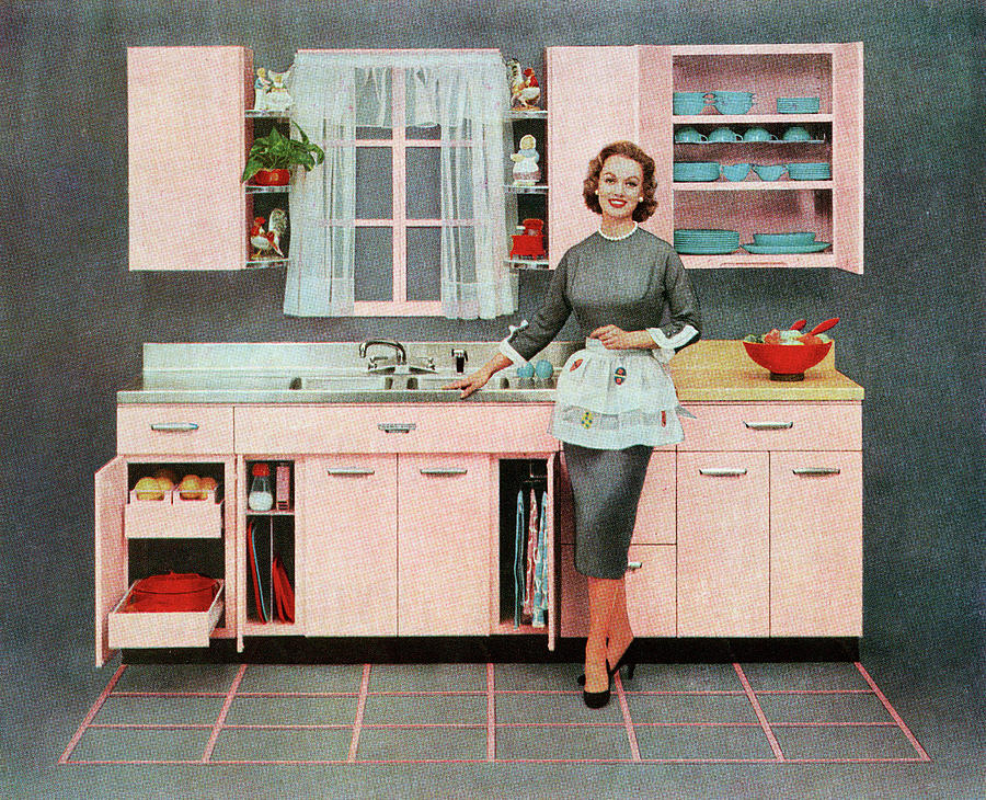 Housewife In Pink Kitchen Photograph by Graphicaartis