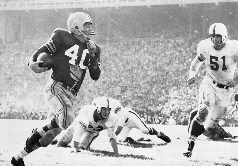 Howard Cassady Running With Football Photograph by Bettmann