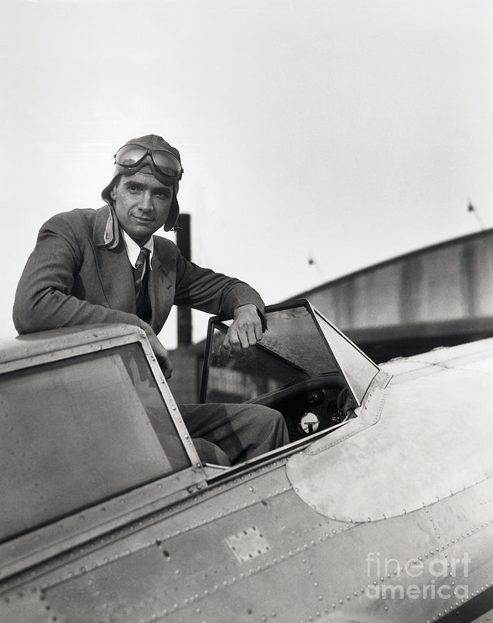 Howard Hughes Posing In Plane Cockpit Photograph by Bettmann