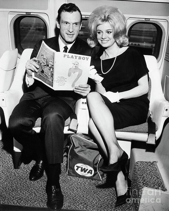 Hugh Hefner And Cynthia Maddoxon Plane Photograph by Bettmann