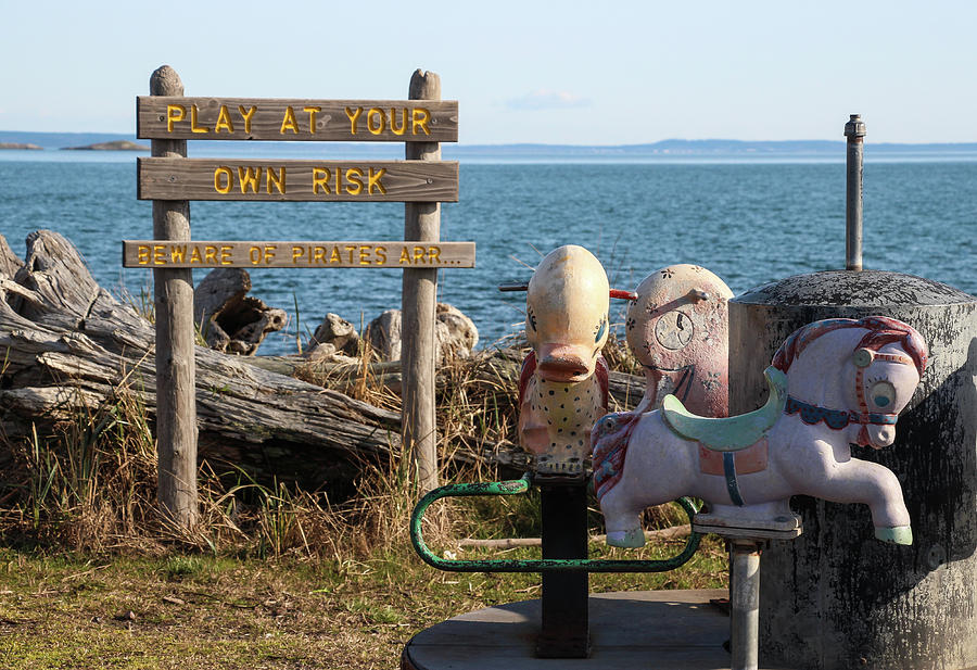 Humorous Sign and Vintage Playground by Pacific Northwest Sailing