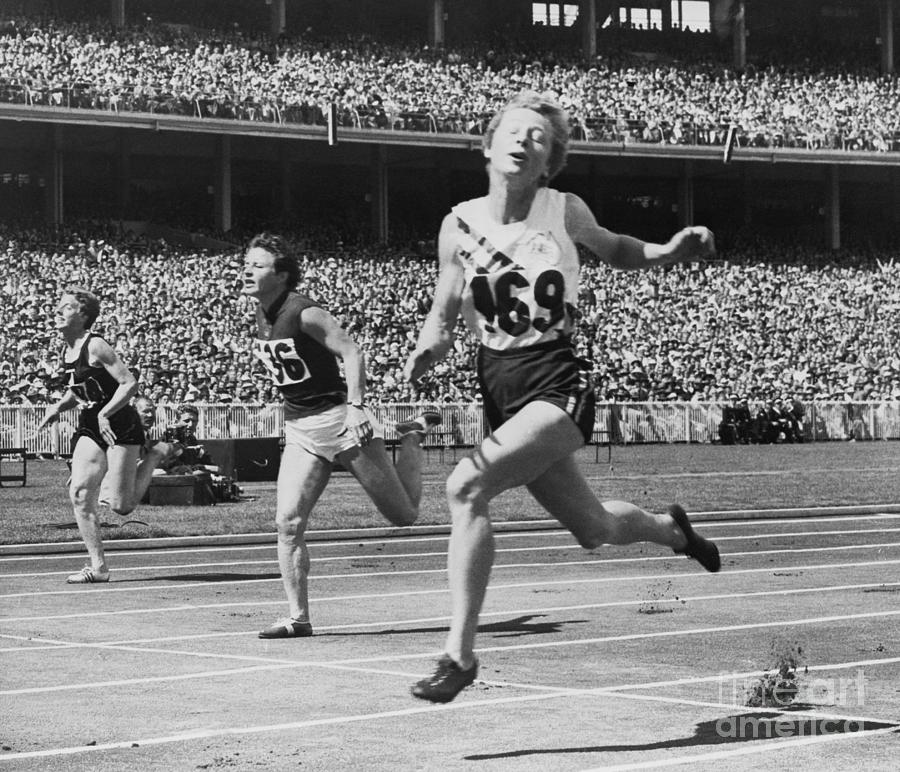 Hurdlers Racing To Finish Line Photograph by Bettmann
