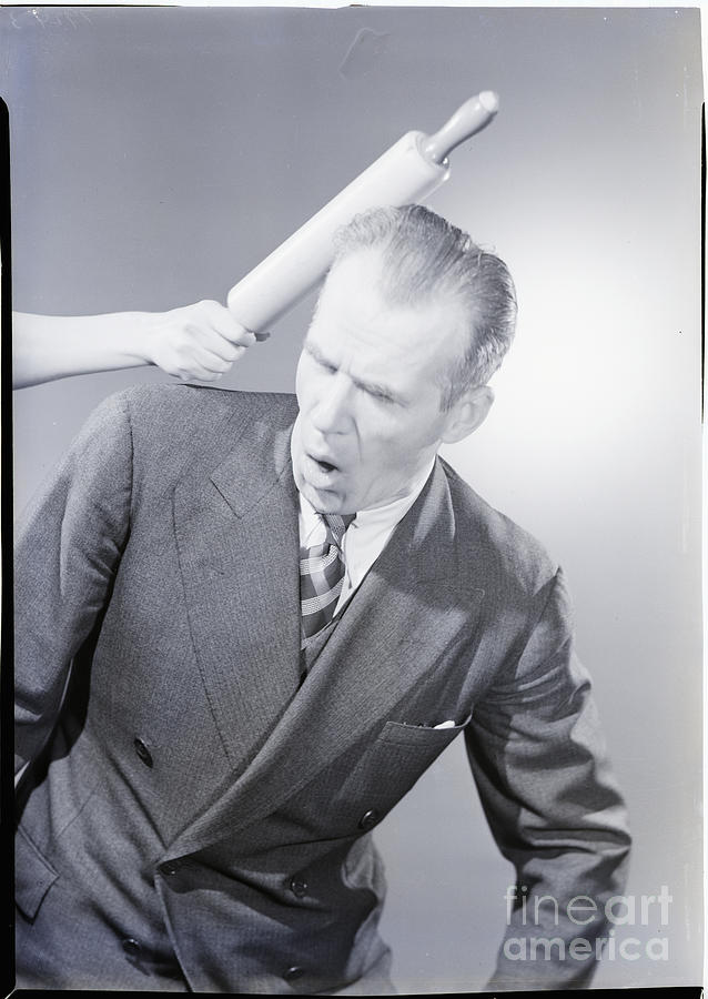 Husband Being Hit With Rolling Pin Photograph by Bettmann
