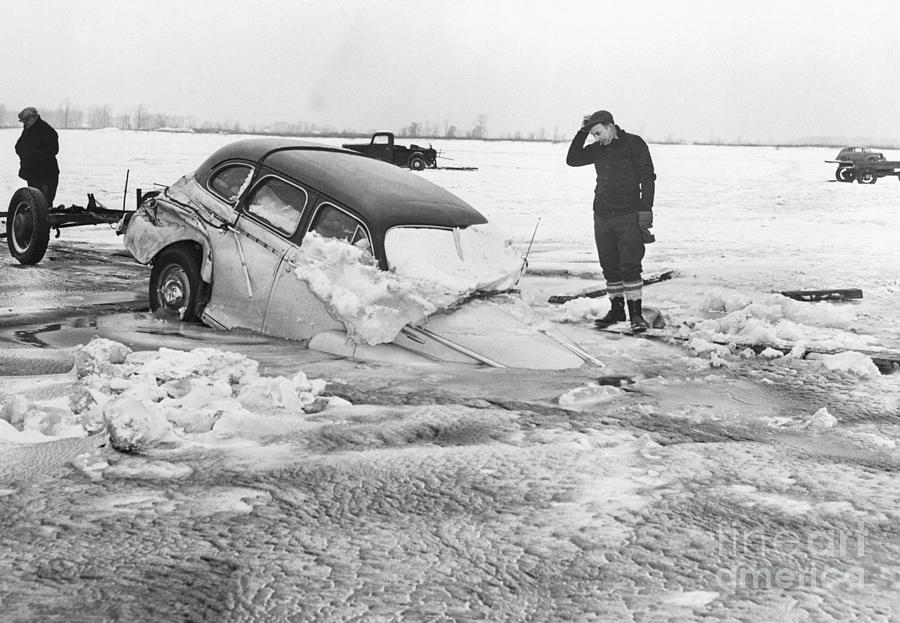 Ice Fishermans Car Sinking On Ice Photograph by Bettmann