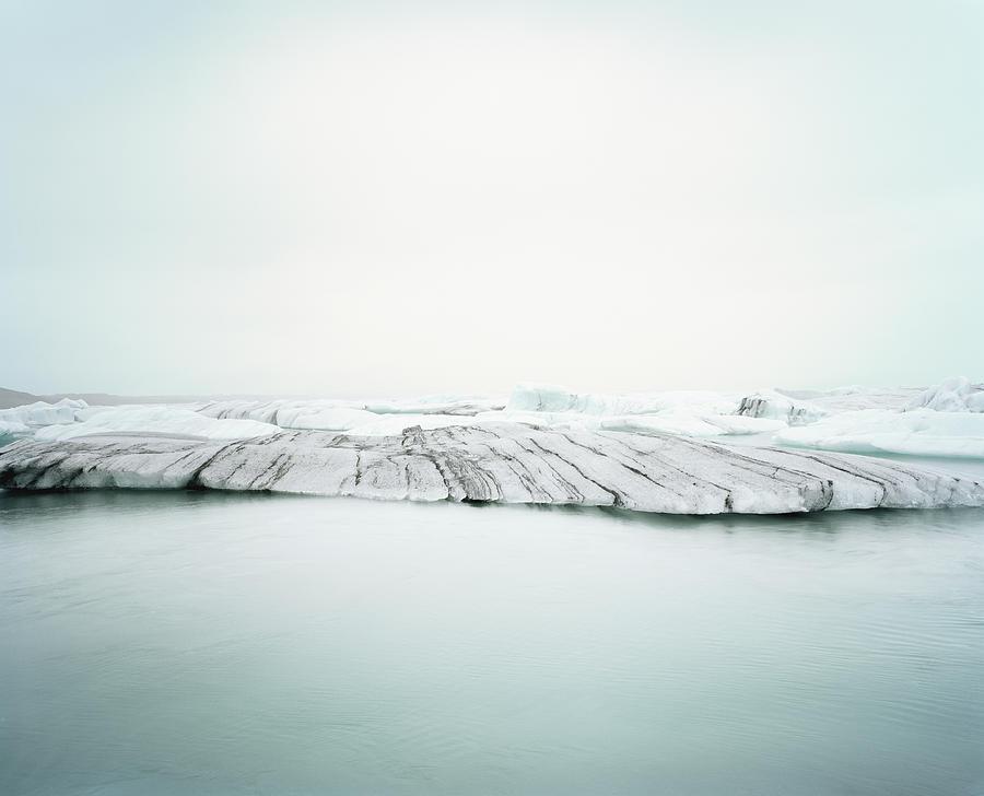 Ice Melt In Jökulsárlón, Iceland Photograph by Michael Hall