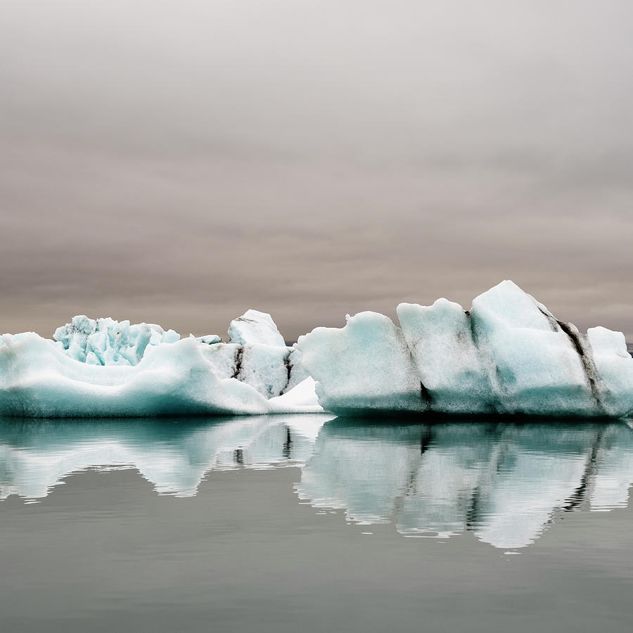 Iceberg In Water Photograph by Roine Magnusson