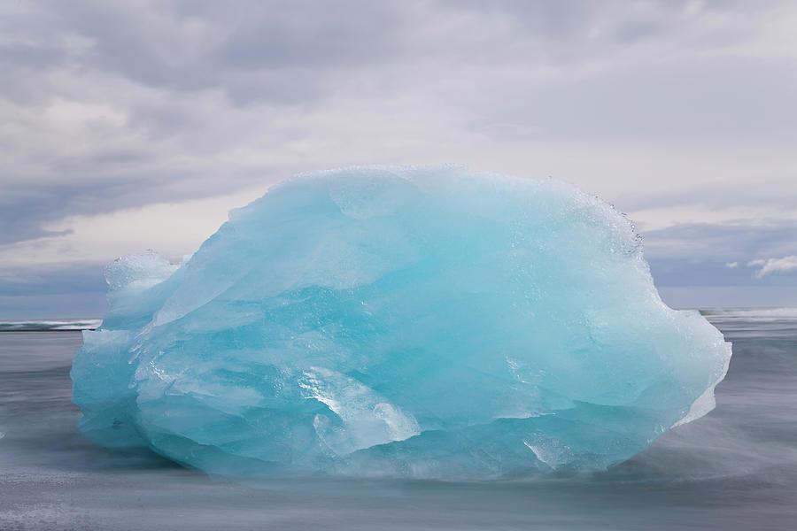 Iceberg On Beach Jokulsarlon Lagoon Photograph by Peter Adams