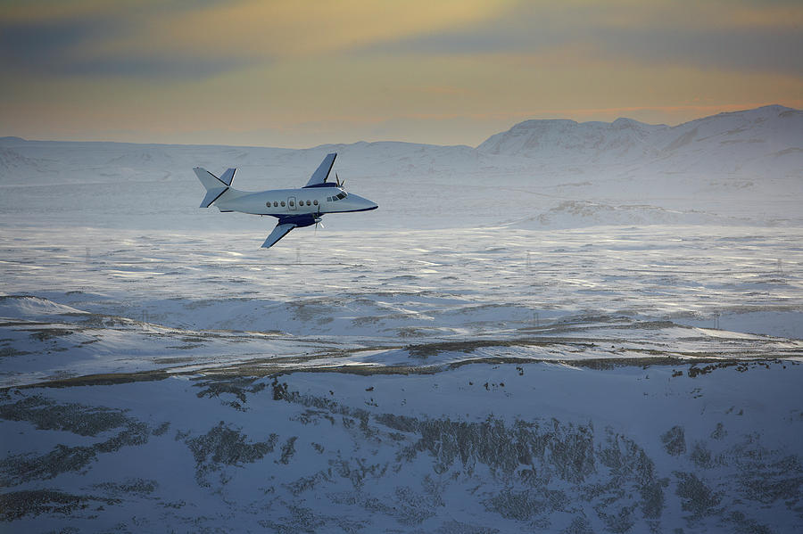Iceland, Cessna Plane Flying Over Snow Photograph by Arctic-images