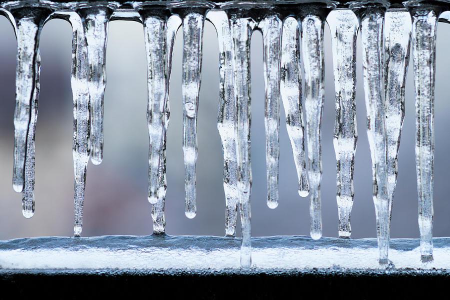 Ice Photograph - Icicles on the Balcony by Razvan Lungu
