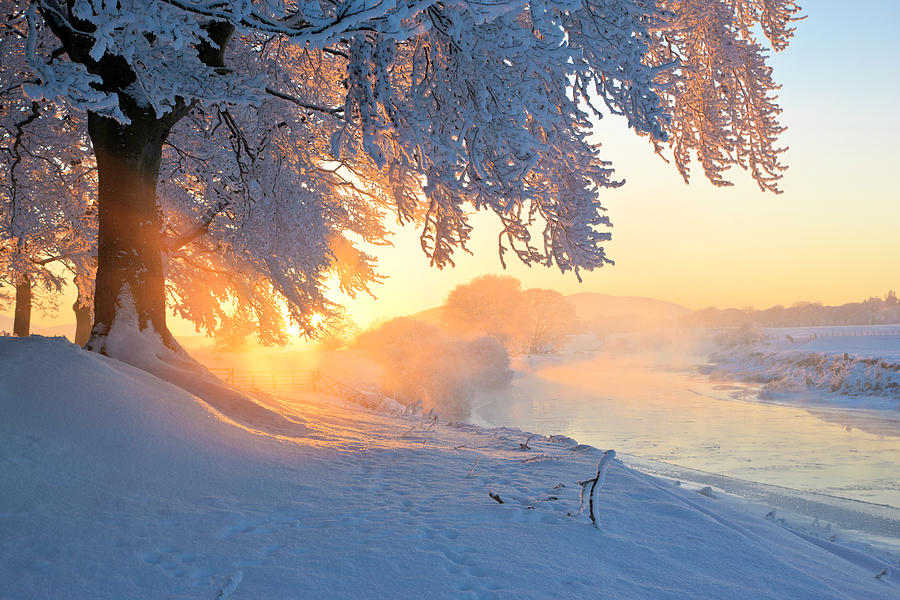 Icy River At Sunset With Frost Smoke Photograph by Simon Butterworth