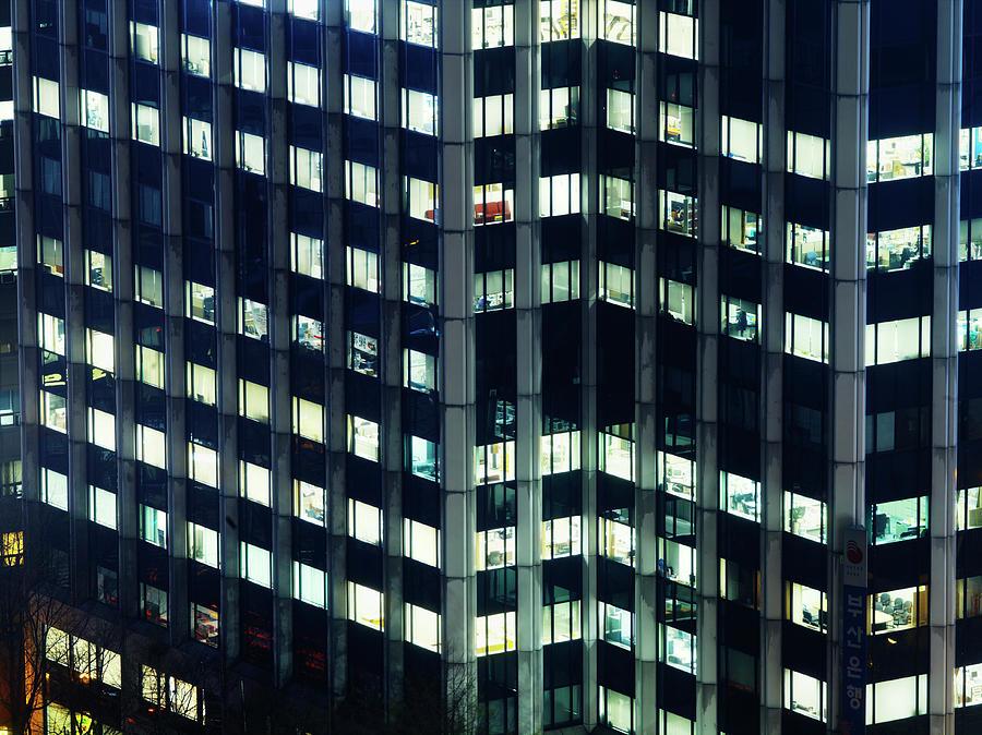 Illuminated Windows Of High Rise Photograph by Henrik Sorensen