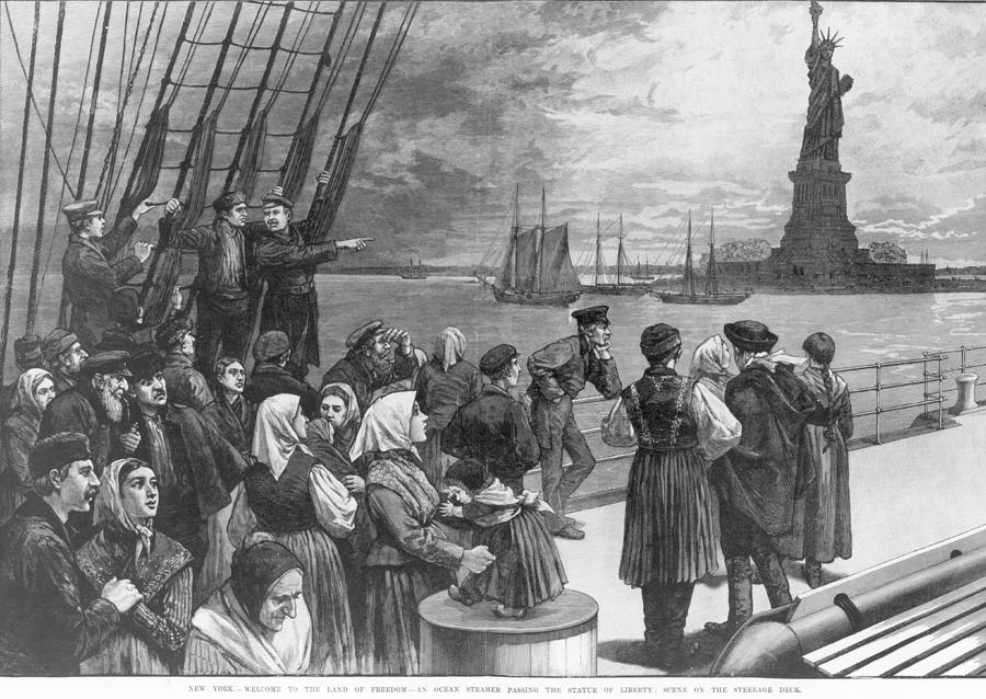 Immigrants View The Statue Of Liberty Photograph by Fpg