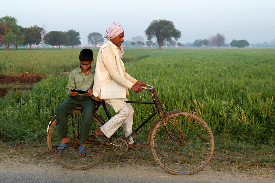 Indian Father Cycling Son To School Photograph by Adrian Pope