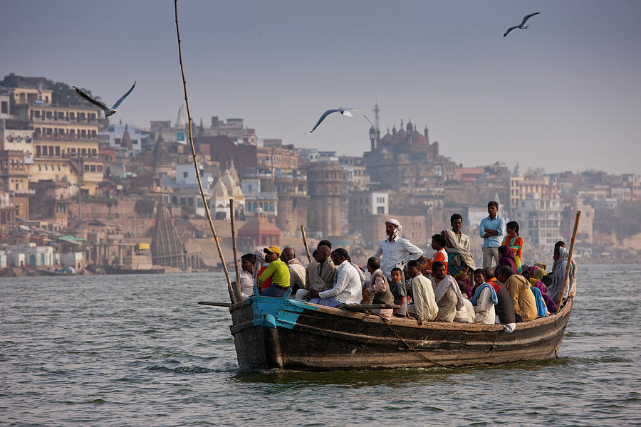 Indians Cruising River Ganges Photograph by Tim Graham