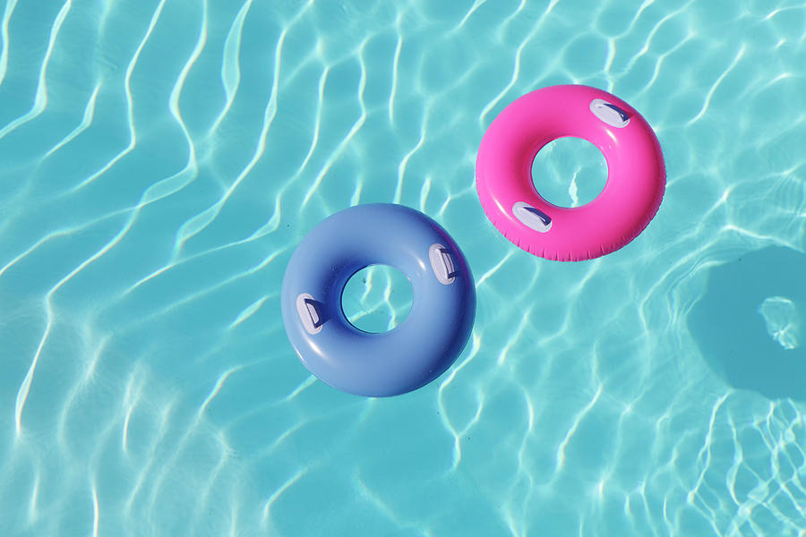 Inflatable Rings In Pool Photograph by Peter Cade
