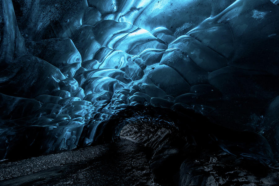 Inside an ice caves in Iceland by Suranga Weeratunga