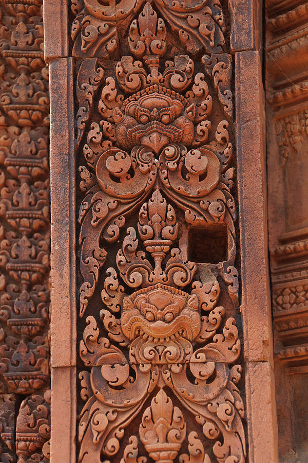 Intricate carvings cover the walls of the temple by Steve Estvanik