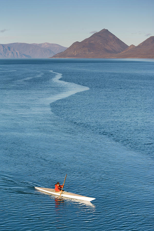 Inuit Man Paddling Traditionally Shaped Photograph by Andrew Peacock