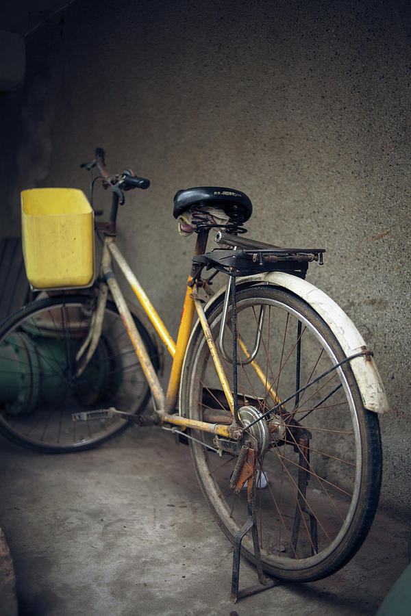 Is That A Yellow Bike Photograph by @xiaoping
