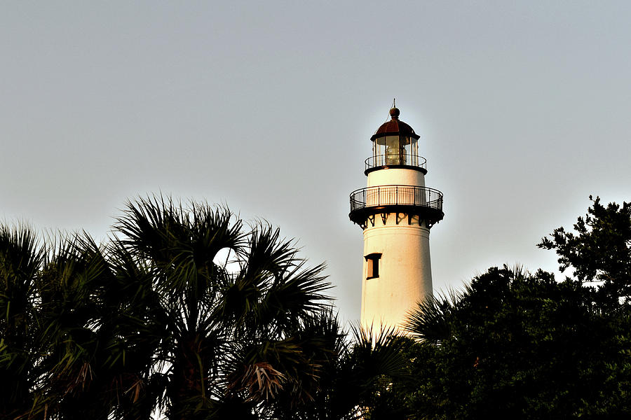 Island Lighthouse At Sunset by Kathy K McClellan