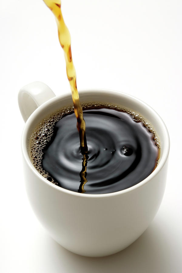 Isolated Shot Of Pouring A Fresh Coffee Photograph by Kyoshino
