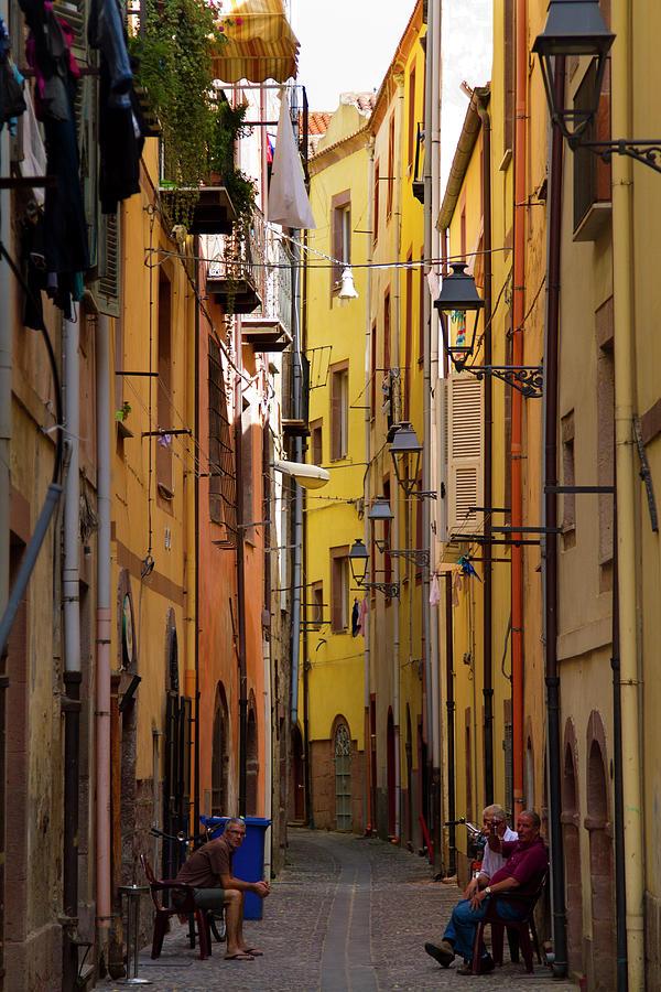 Italy, Sardinia, Bosa, Sitting In The Photograph by Aldo Pavan