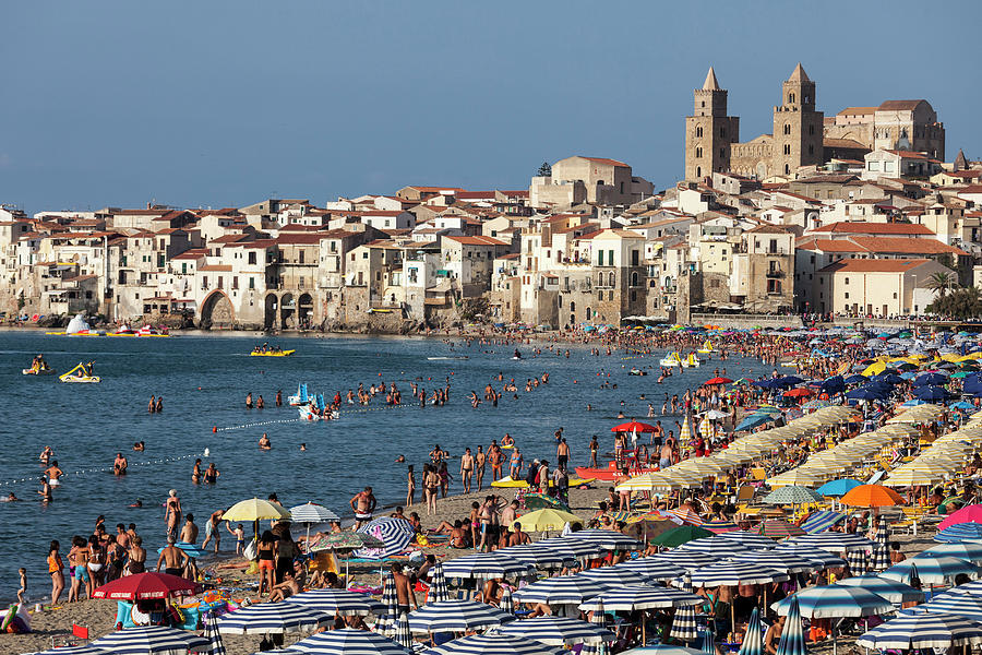Italy, Sicily. Cefalu. Bathers On  The Photograph by Buena Vista Images