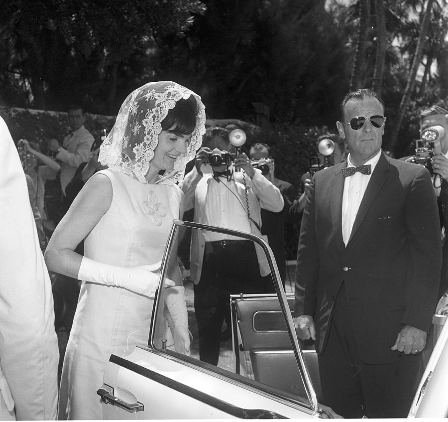 Jackie Kennedy Enters A Car As She Photograph by Bert Morgan