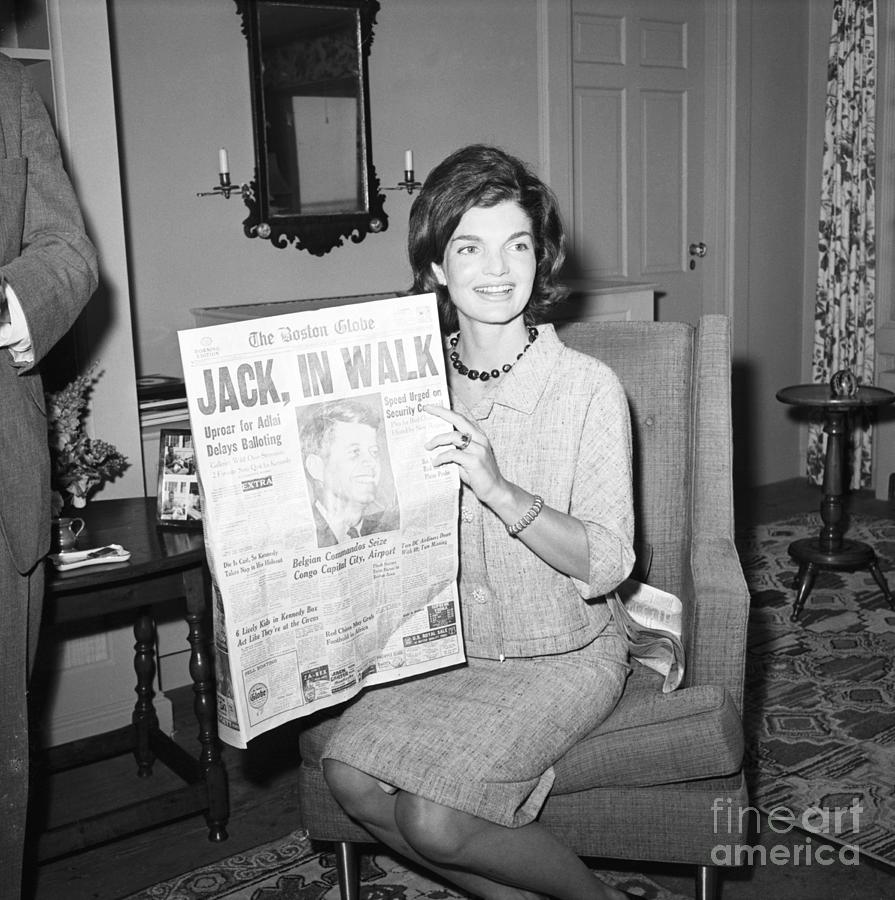 Jacqueline Kennedy Holding Newspaper Photograph by Bettmann