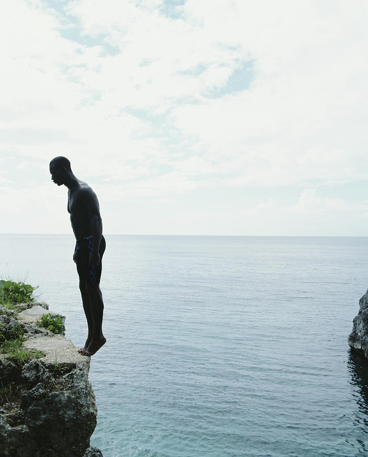 Jamaica, Negril, Man Standing On Edge Photograph by Momo Productions