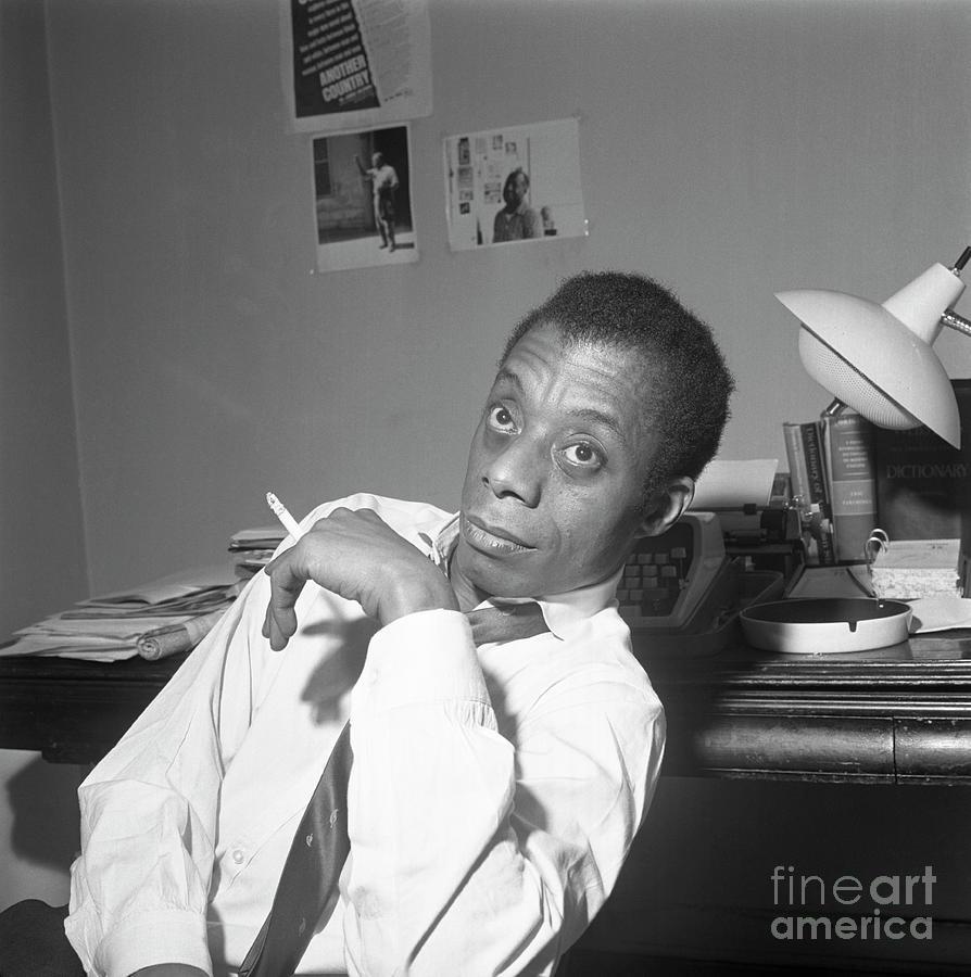 James Baldwin Sitting Smoking Photograph by Bettmann