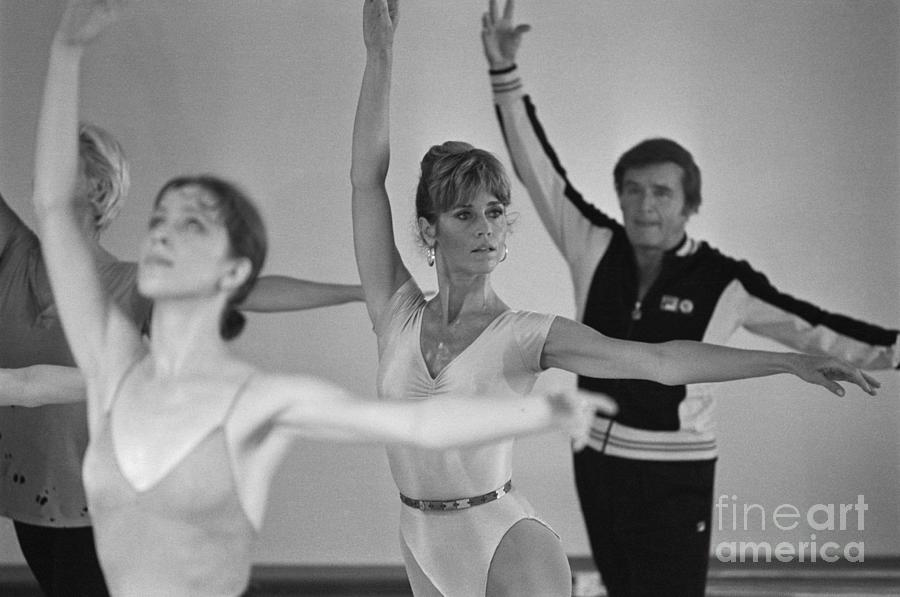 Jane Fonda And Mike Douglas Exercising Photograph by Bettmann