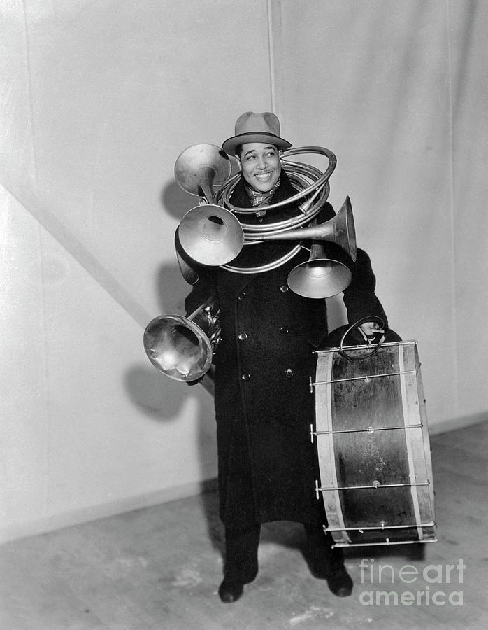 Jazz Musician Duke Ellington Carrying Photograph by Bettmann