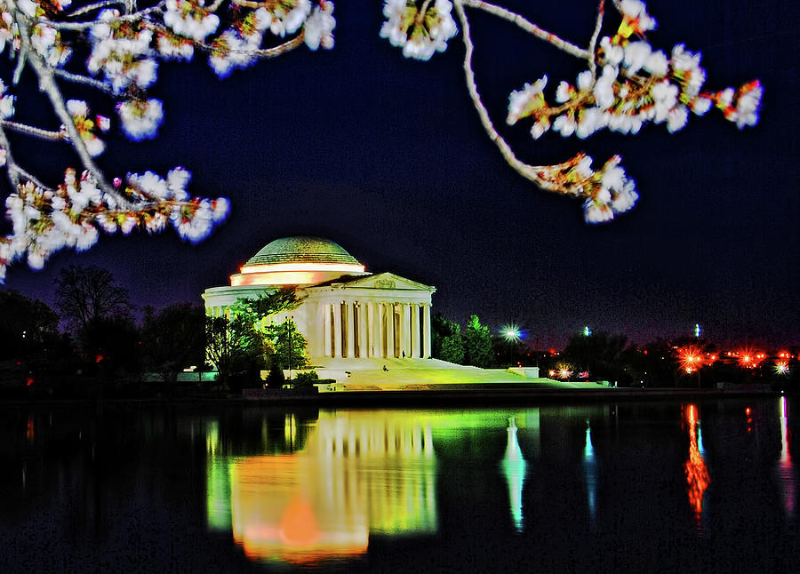 Jefferson Memorial at night with cherry blossoms by Bill Jonscher