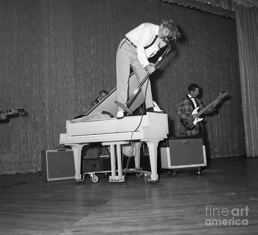 Jerry Lee Lewis Singing Atop A Piano Photograph by Bettmann